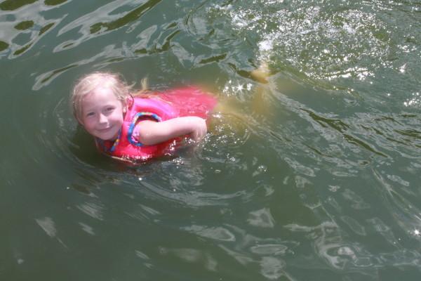 swimming at boat